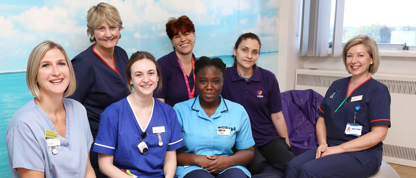 Picture of maternity staff sitting in a room smiling