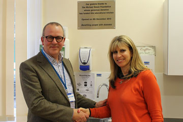 Picture of Steve Barnett, Chairman, shaking hands with Joanne Green, founder of the Michael Green Foundation