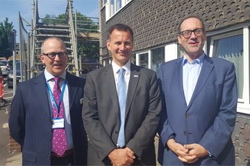 Left to right - picture of Professor Steve Barnett, Chair; Jeremy Hunt, Secretary of State for Health and Social Care; Richard Harrington, MP for Watford standing outside Willow House at Watford Hospital