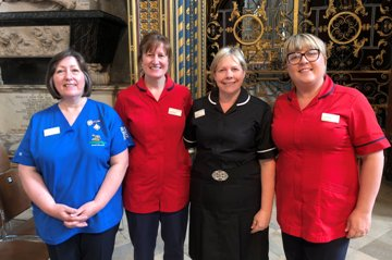 Picture of four nurses standing together in Westminster Abbey